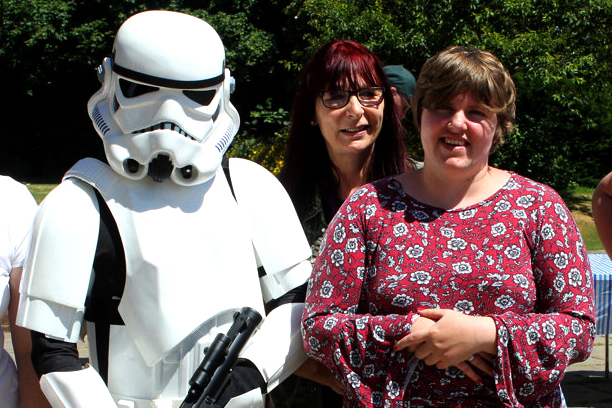 Support Worker with lady supported through autism west midlands and person dressed up in Starwars costume