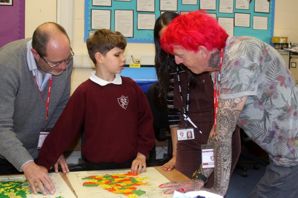 Alan and the children looking at the braille map