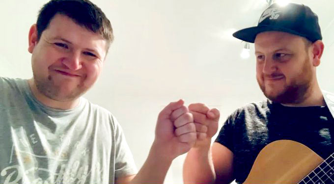 Scotty and Liam 'fist bumping' and smiling